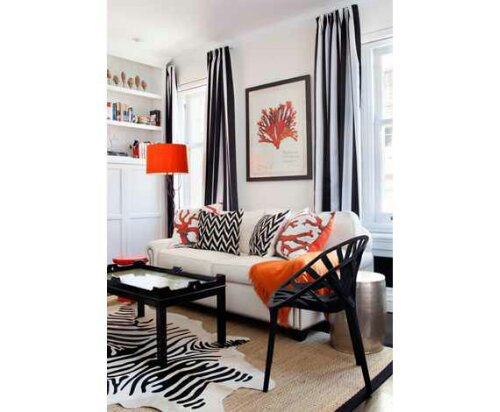 Lot of black and white with pops of orange just adding color in a